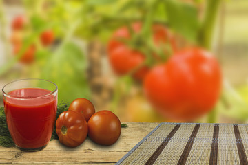 Juice tomato on wooden background