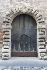 Ancient wooden gate in Rimini, Italy