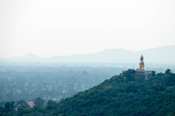 Giant Budda image on hill, face to Petchaburi town, Thailand. Mood and tone version.