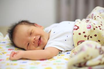 newborn baby sleep and smile