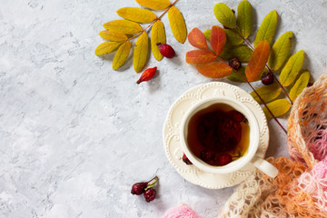 Tea from the hips, and the autumn leaves and a warm scarf on a c