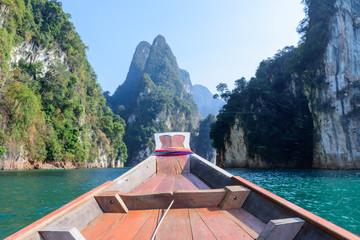 Ratchaprapha Dam ,THAILAND February 20,2016:Boat and Beautiful mountain
