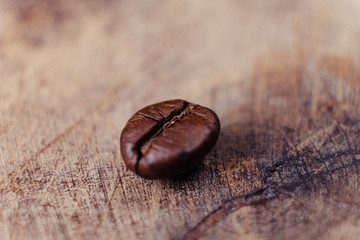 Coffee Bean on wood background with filter effect retro vintage