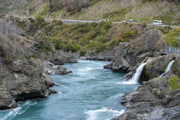 The Roaring Meg (Te Wai a Korokio) the turbulent stream that both drives this hydro electric power station and merges with the Kawarau River, Central Otago, south island of New Zealand