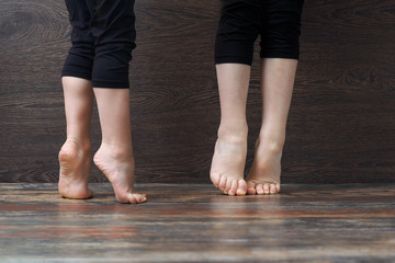 Children's feet on the floor standing on tiptoe