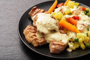 Grilled pork tenderloin and boiled vegetables with cream mustard sauce.