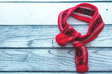 Background, light wood and red scarf. The concept of a new year. A place for a label. Winter vintage postcard