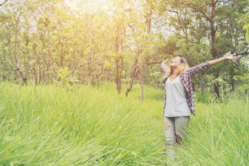 Young woman enjoying nature in the middle of a meadow.