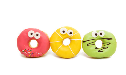 delicious donuts in color glaze isolated