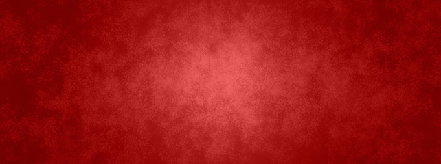 Red background in Christmas or valentines day red color with vintage texture and shiny center spot