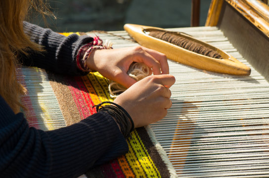Crafts. Hand weaving loom with many colorful woolen threads.