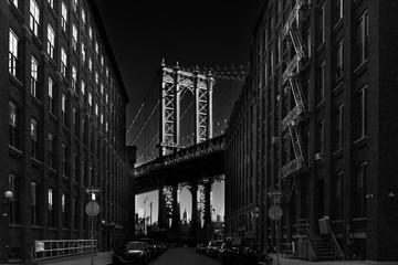 Manhattan Bridgeas at dusk as seen from Washington street in Brooklyn, New York City, USA. Motion...