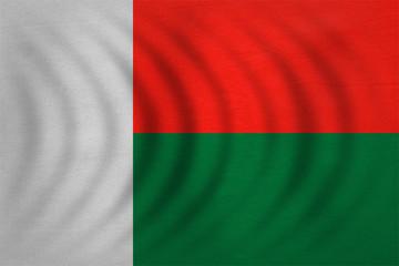 Flag of Madagascar wavy, detailed fabric texture