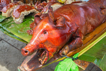 Barbecue pork on green table. Lechon or liempo - traditional dish of Philippines.