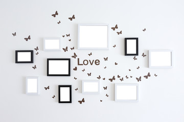 Love picture frames on white wall