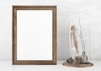 Vertical vintage poster mockup with wooden frame, feather and twigs on empty white wall background. 3D rendering.
