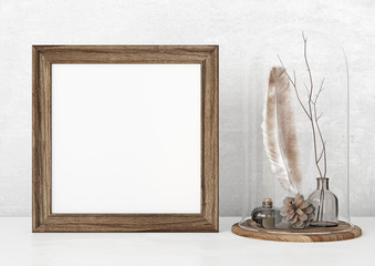 Square vintage poster mockup with wooden frame, feather and twigs on empty white wall background. 3D rendering.