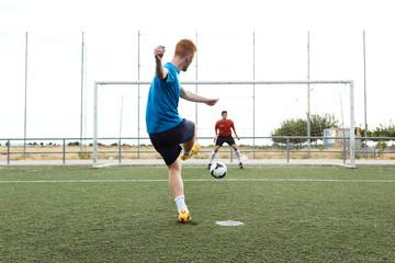 Player kicking a soccer ball