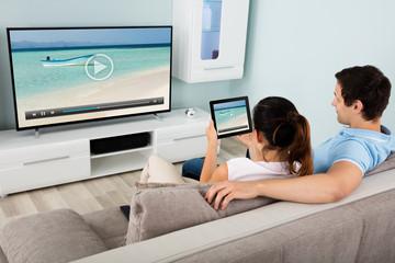 Couple Watching Movie Using Digital Tablet