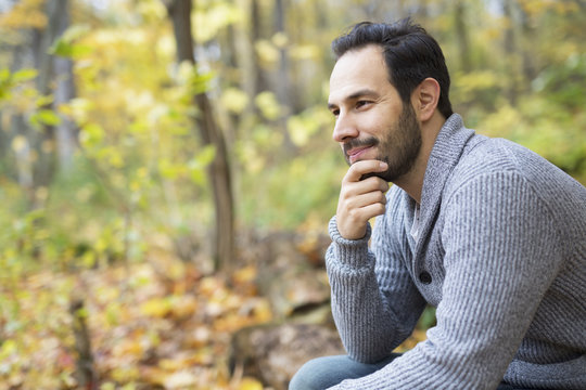 middle-aged man alone on beautiful autumn day