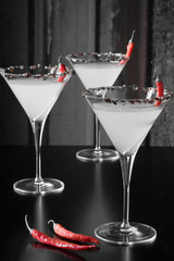Black and White Martinis with Red Chili Peppers
