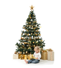 Child baby girl kid sitting and open new year present near decor