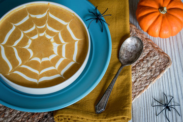 Halloween Pumpkin Soup with Sour Cream Spiderweb