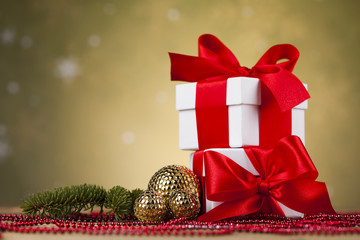 Christmas background with decorations and gift boxes on wooden