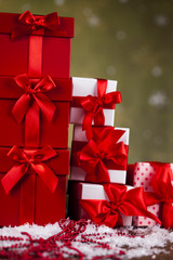 Gift boxes with red ribbon on Christmas background