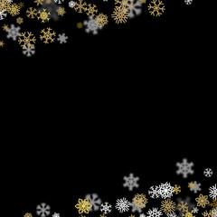 Snowfall background with golden snowflakes blurred in the dark