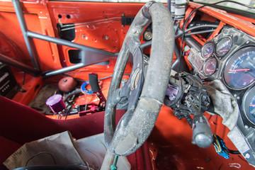 steering wheel , old interior of ruined truck