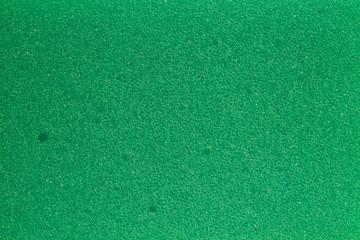 texture of green polymeric foam material, macro image..