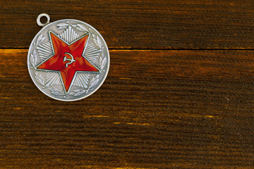 Soviet military award on a wooden board.