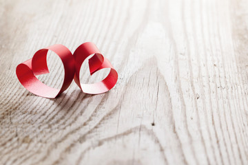 Ribbon hearts on wooden background