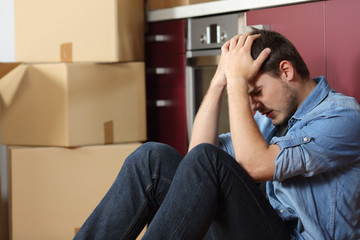 Sad evicted man worried moving house