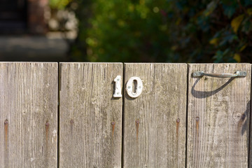 House Number 10 sign on gate