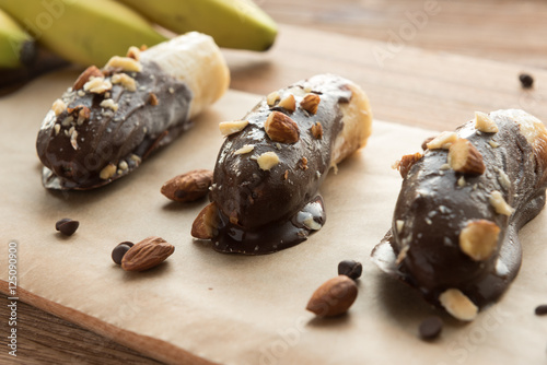 "Mini chocolate covered frozen bananas with almonds""Fotolia.com の ..."