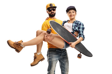 Bearded man carrying a female skater with a longboard
