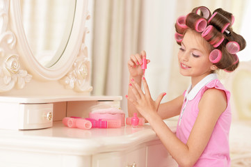 Little pretty girl   in hair curlers