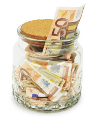 Money notes in a glass jar
