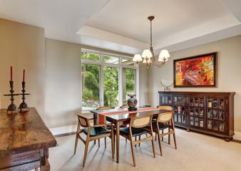 Enclosed dining room interior with retro details