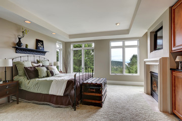 Master bedroom interior with lots of pillows on iron bed