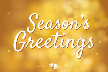 Season's greetings with gold bokeh background for christmas them