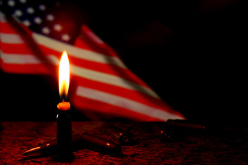 Candles flag funeral mourning in USA with weapons dark background.