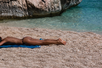 Young Woman Topless Relaxed under the Sun at Beach