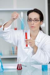 female physician with syringe