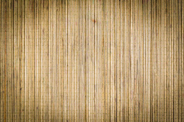 Bamboo mat background surface texture with vignette and antique filter applied to image ideal for Asian or Oriental subjects