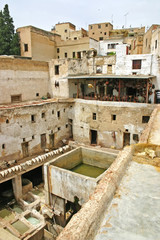 City skyline, drying hides and dye pots at one of the tanneries