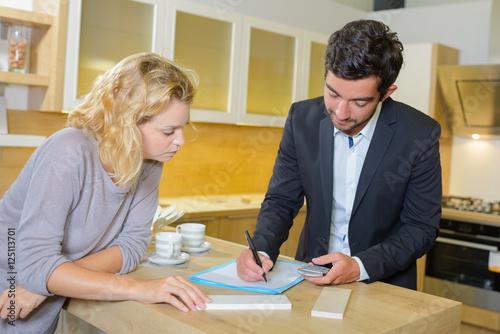Interior designer writing an estimate photo libre de - Estimation and costing in interior designing ...