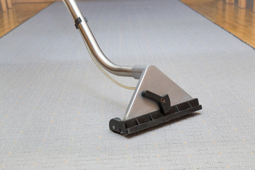 Carpet chemical cleaning with professionally extraction method. Early spring cleaning or regular clean up.
